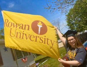 Jodi waving a rowan university flag