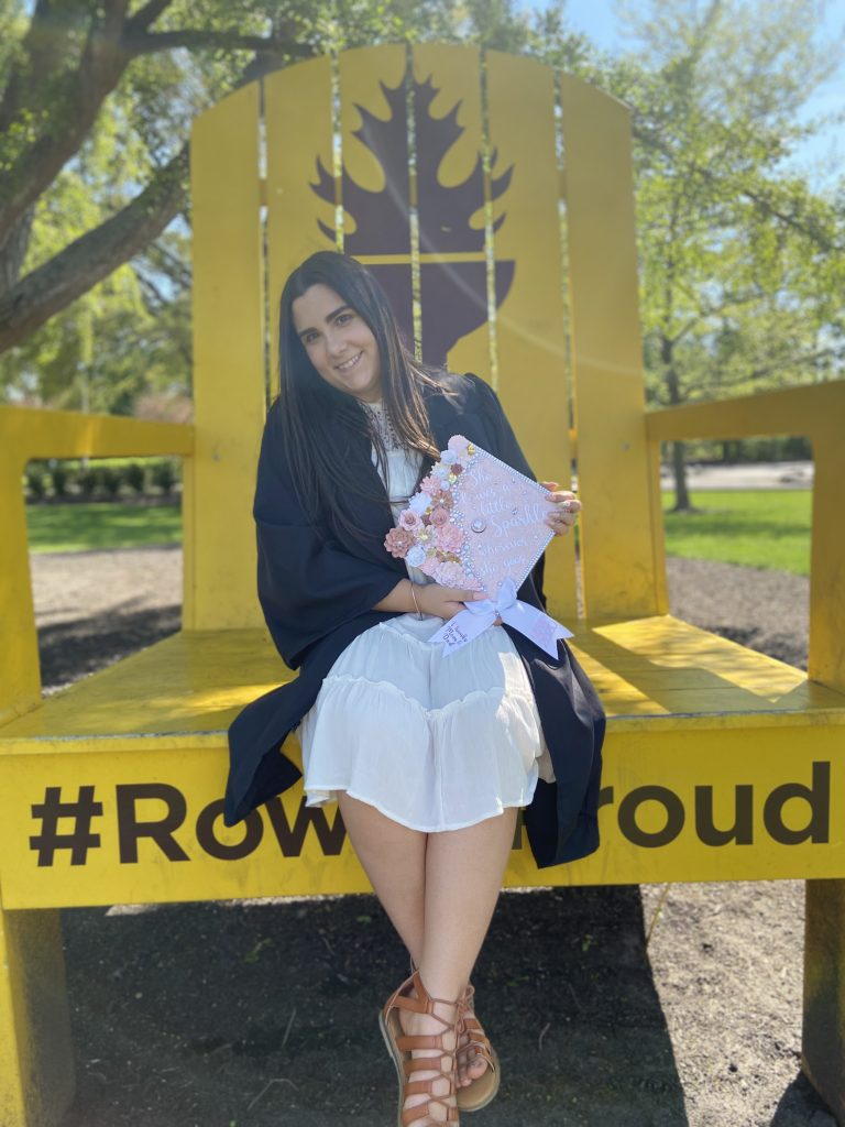 Photo of chemistry major Mia in her cap and gown.