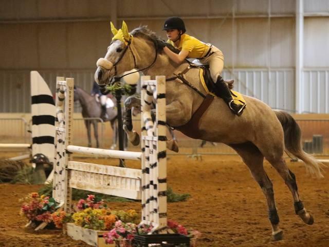 Molly riding a horse.
