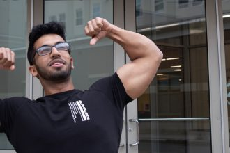 Krishna flexing his muscles outside 232 Victoria St.