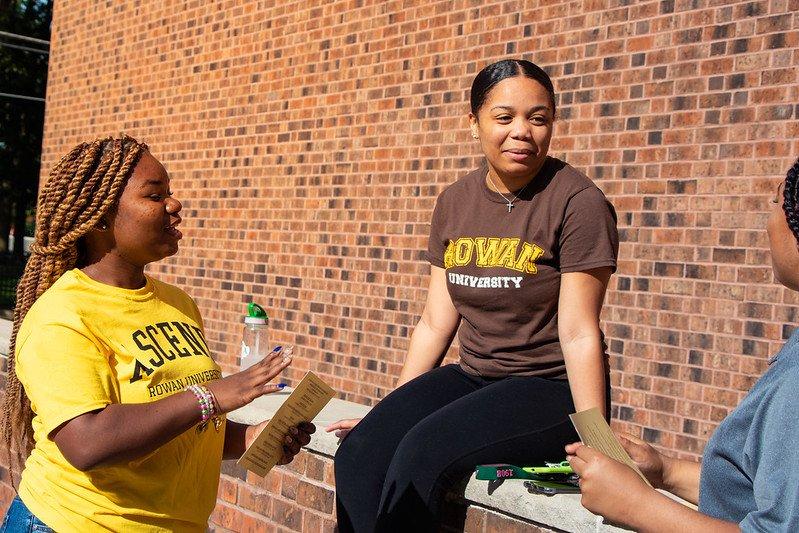 Three students talking outside Chamberlain Student Center