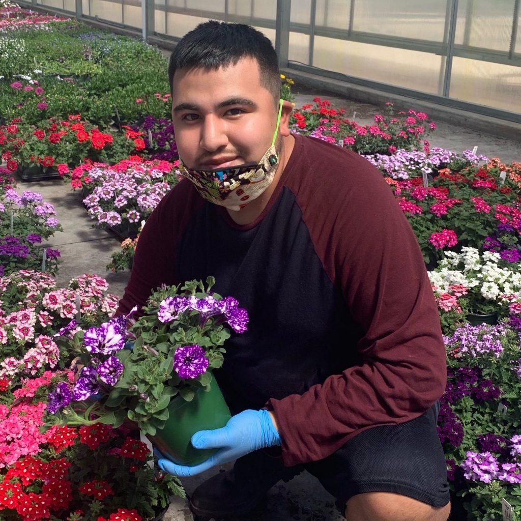 Edgar working inside Lucas Greenhouse, where he shot the viral graduation video
