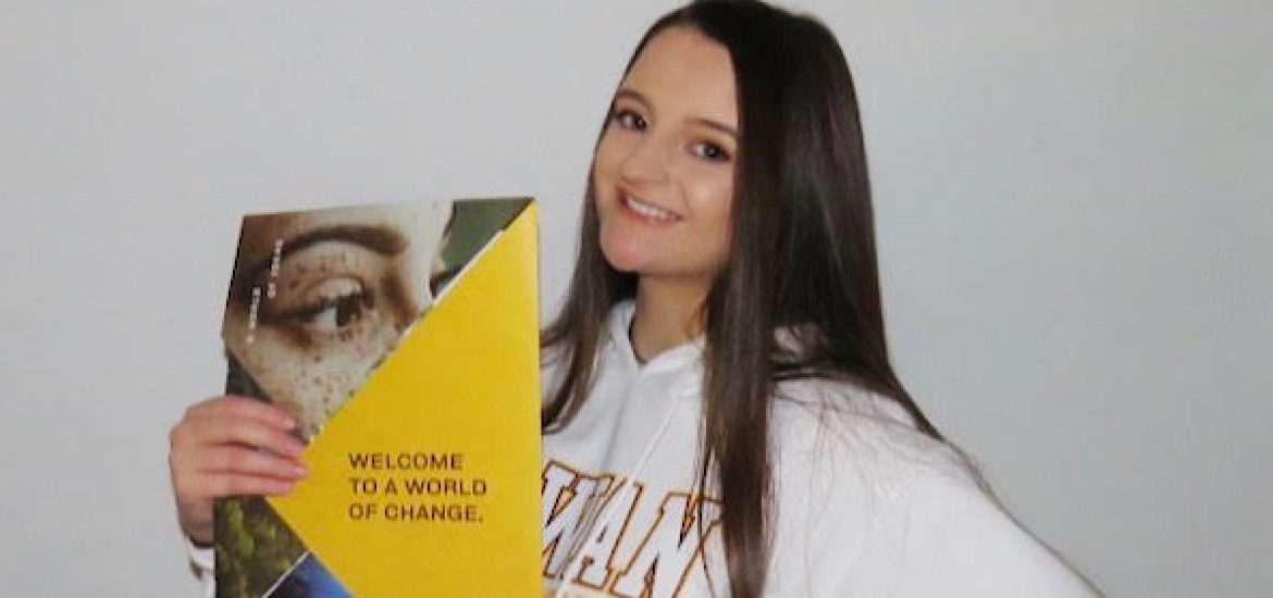 Photo of Brianna holding her admissions packet