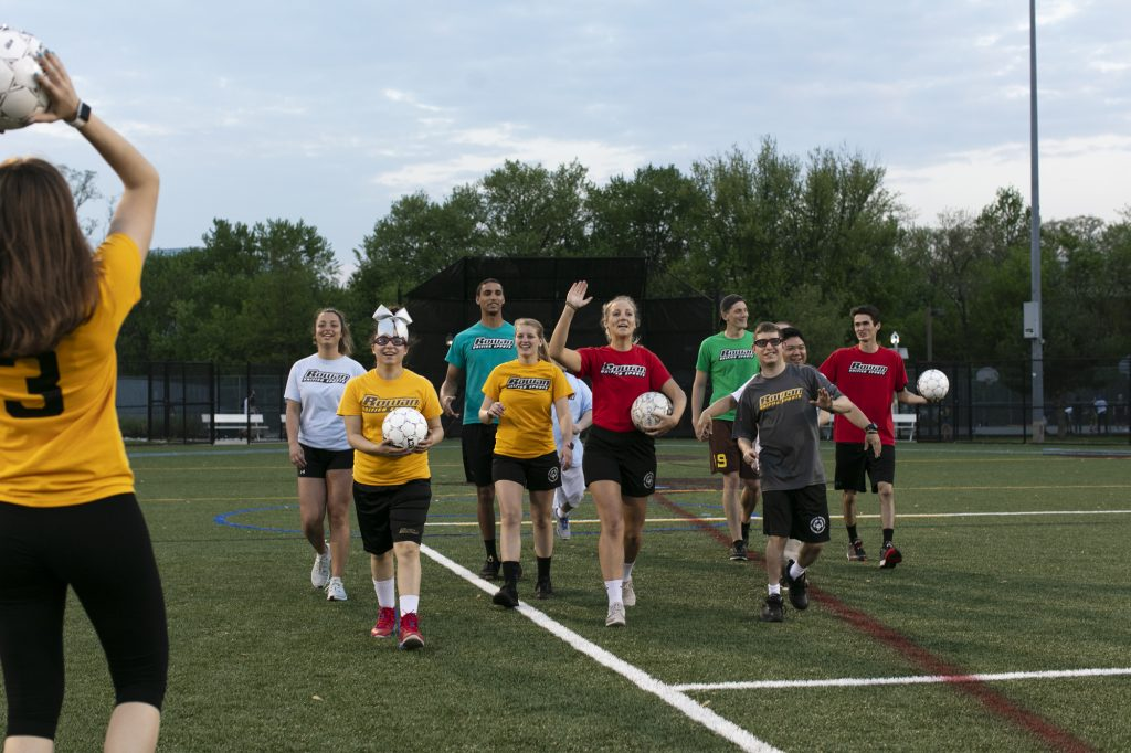Unified Sports club walking on the soccer field.