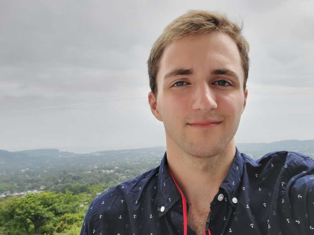 Sean smiling for a selfie overlooking mountains in Japan.