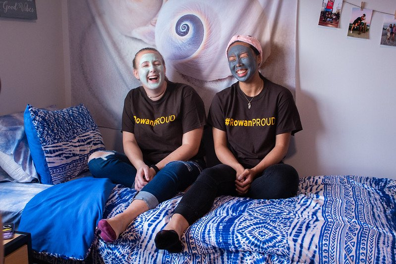 Two students get a mask treatment inside their residence hall