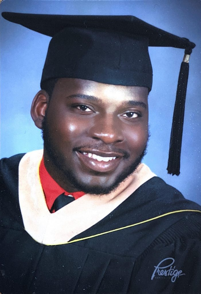 Headshot of Byron in his graduation cap and gown.