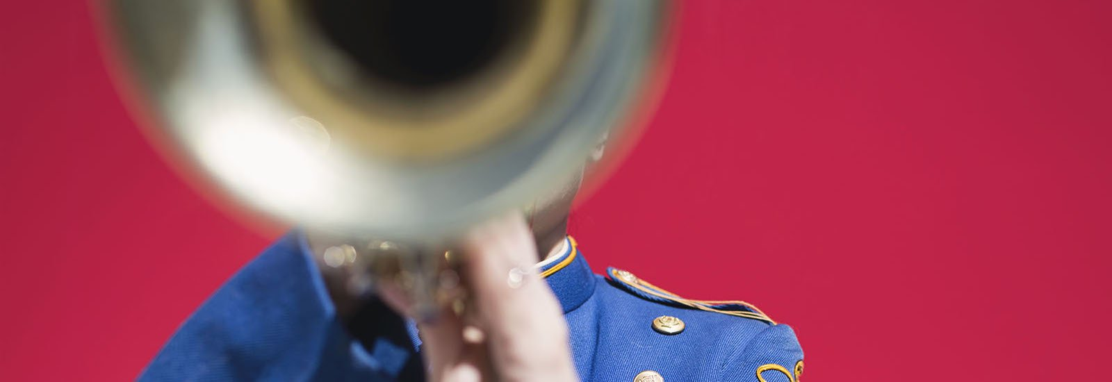stock image of a trumpet player against a red background