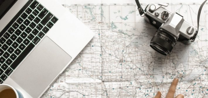 stock image of a laptop, map and a camera
