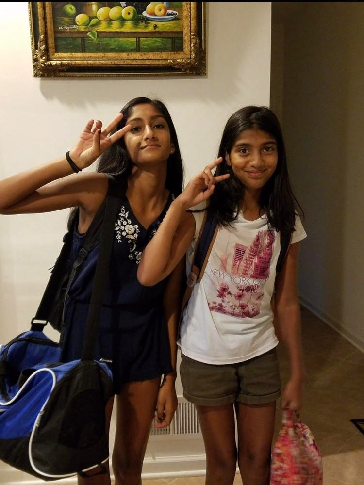 Navya poses with her friend.