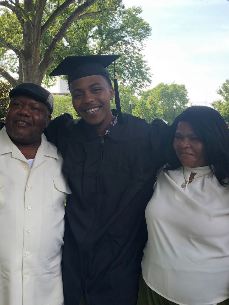 Peterson celebrates his commencement with family