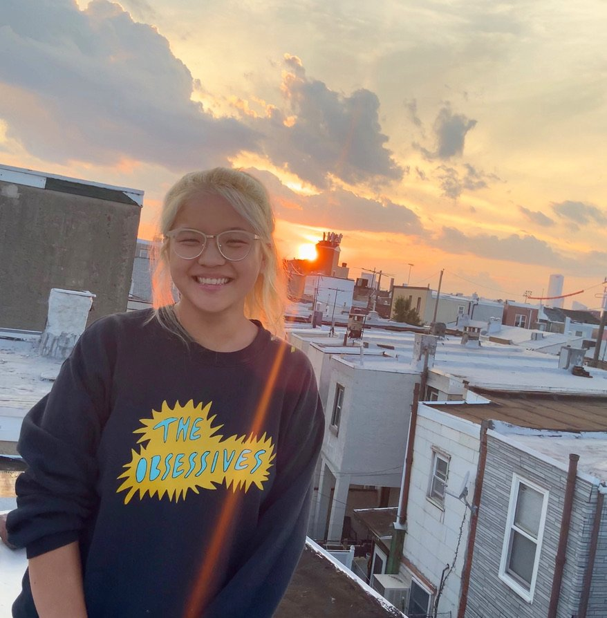 Bioinformatics major Molly Miraglia smiles while standing on a rooftop.