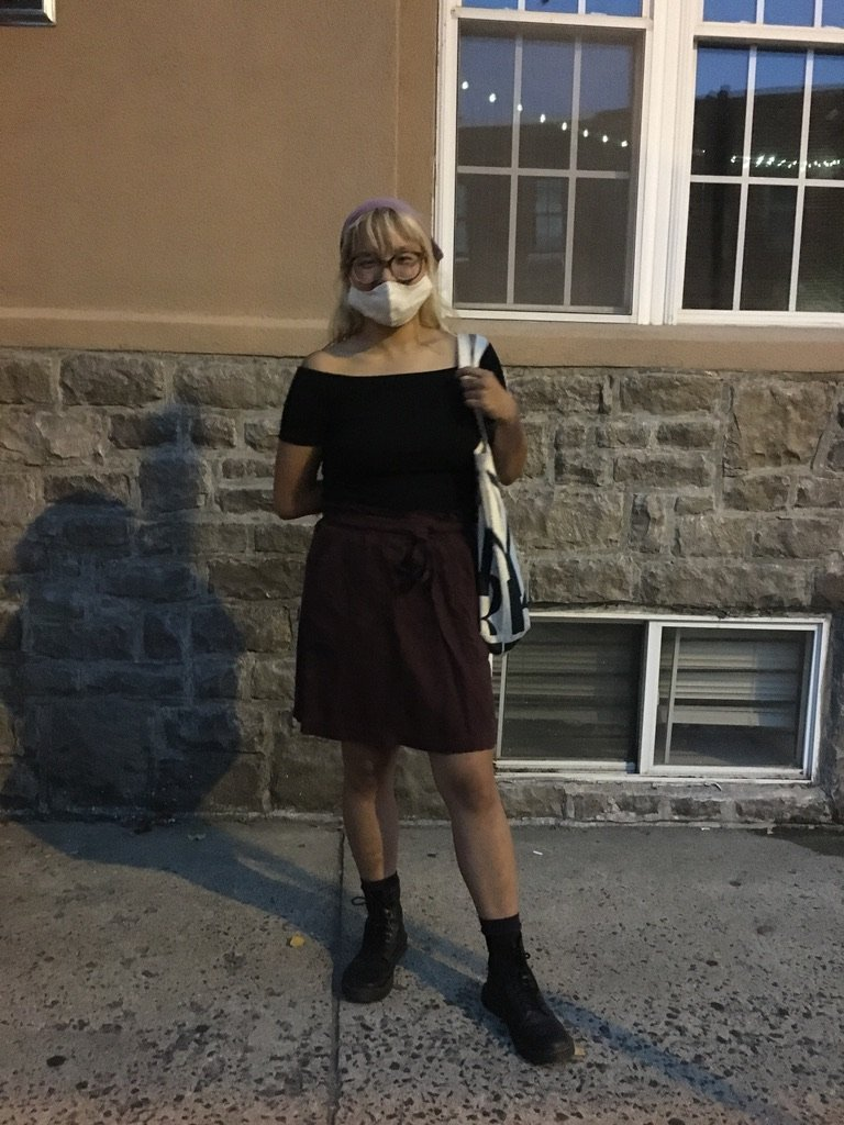 Bioinformatics major Molly Miraglia wears a mask her friend made for her.
