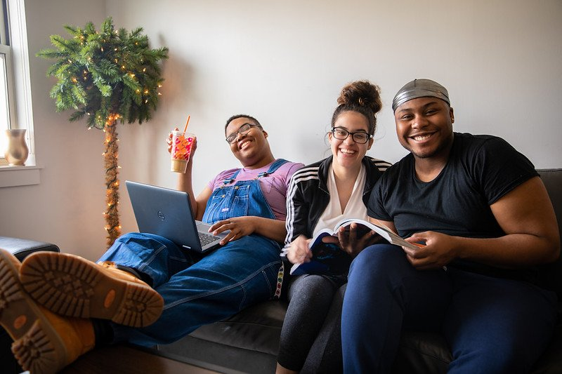 Three roommates hang out and study together