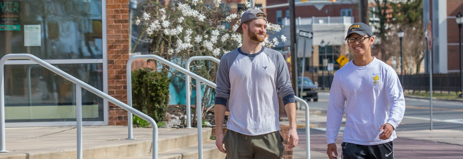 Chris Finnegan and friend walk down campus