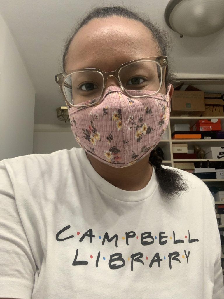Psychology major Autumn Cruz wears a floral mask.