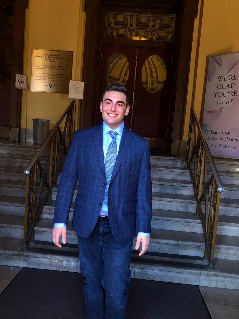 Political science major Brian Kreimer wears a suit
