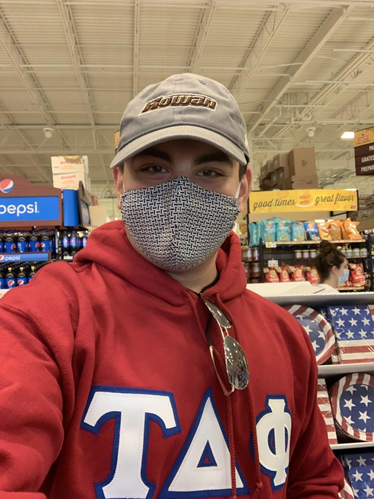 Political science major Brian Kreimer wears a mask inside a grocery store
