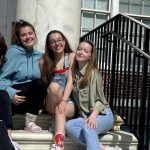 Erica sitting with friends on the Bunce Steps