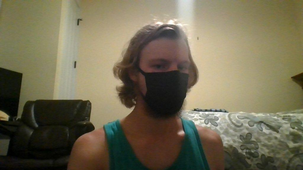 Civil engineering major Max Husar displays the black mask he wears