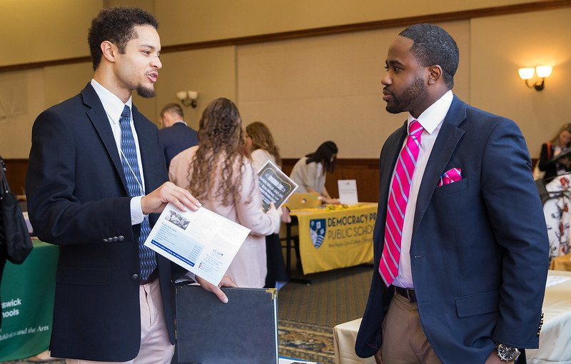 Student speaks with a career representative in the student center.