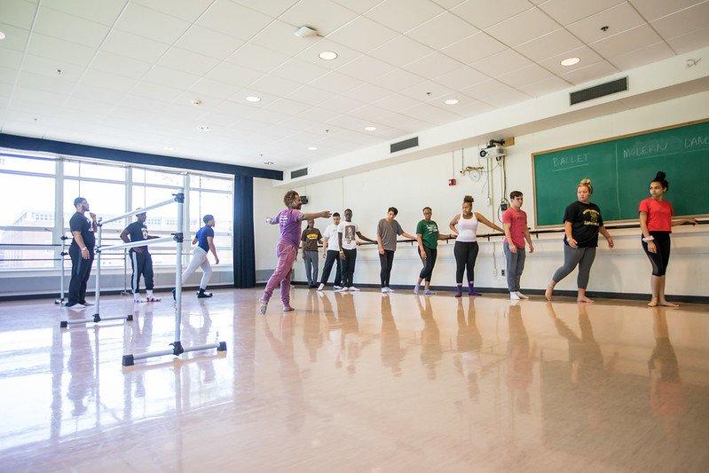 Professor leads a dance class.