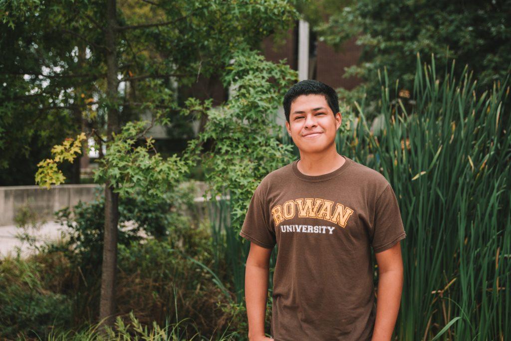 Erwin stands outside wearing a Rowan t-shirt.