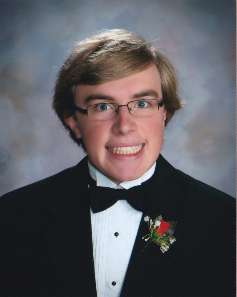 Larry smiling in his high school graduation photo.