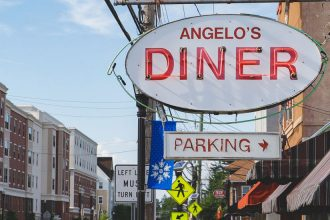 External shot of Angelo's Diner and Main St.