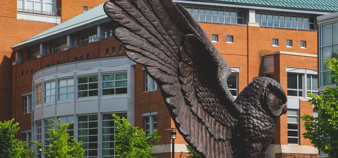 Exterior shot of the Owl statue and the back of Campbell Library.