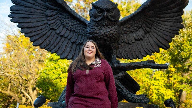 maribeth in front of prof statue