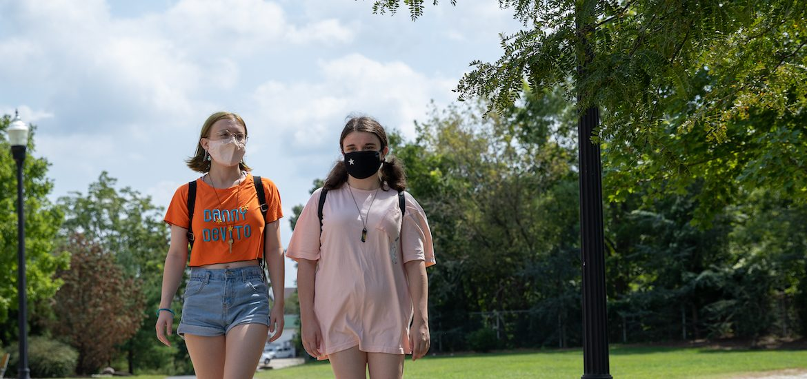 Sammy and Vicky walk together on campus.
