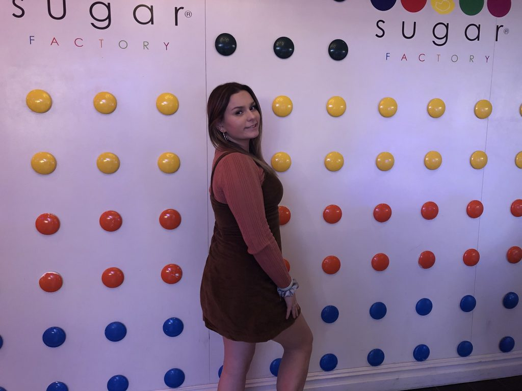 Cait posing for a photo at the Sugar Factory restaurant.