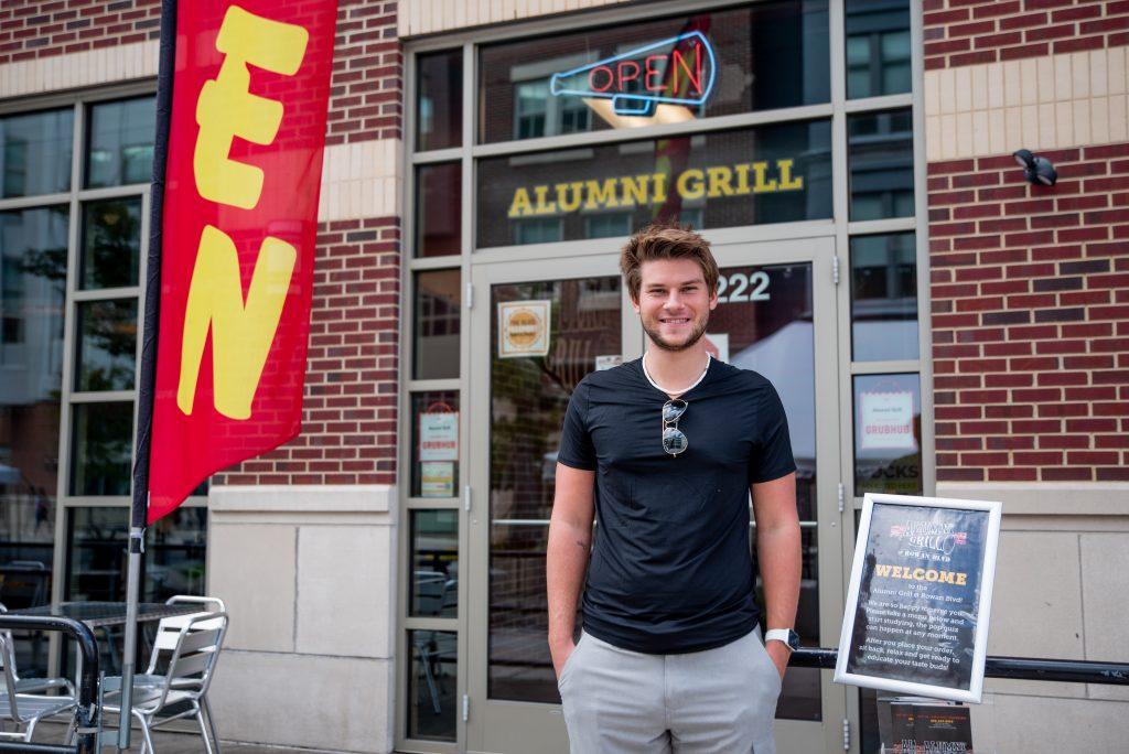 Dan standing outside of Alumni Grill.