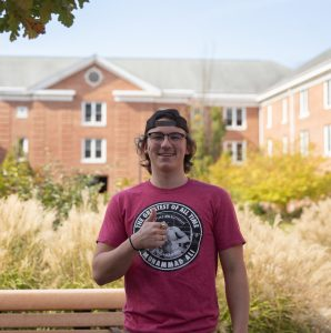 Griffin gives a thumbs up with a backwards hat in front of Chestnut.