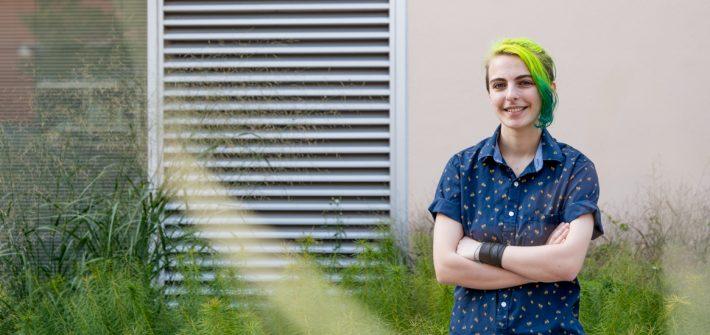 Hannah standing outside