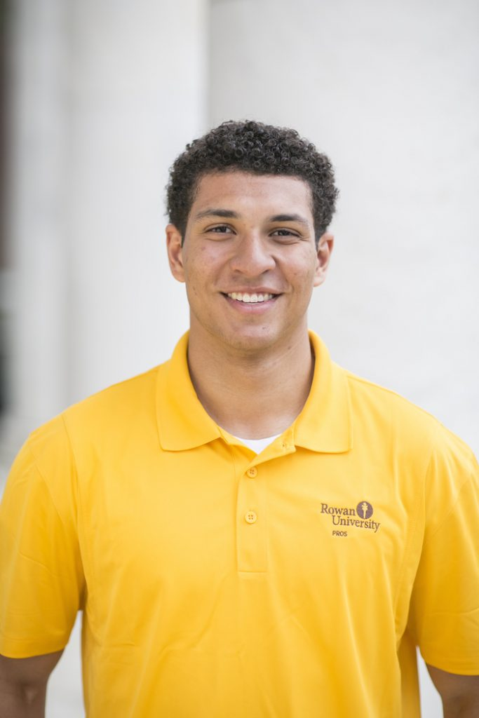 Brandon posing for a picture while wearing his Rowan University PROS shirt.