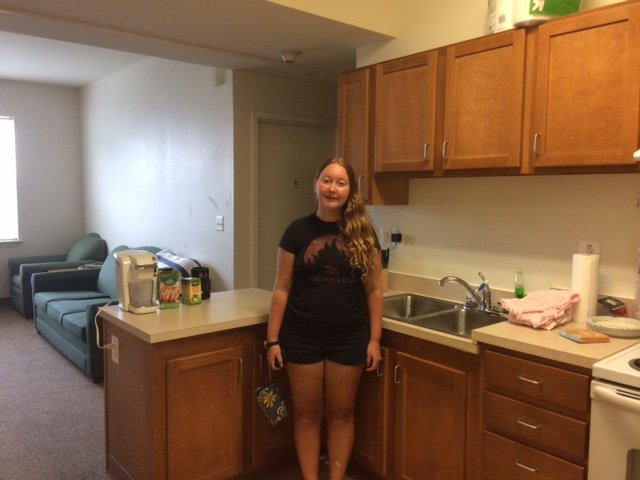 Rachel in her kitchen in her apartment.