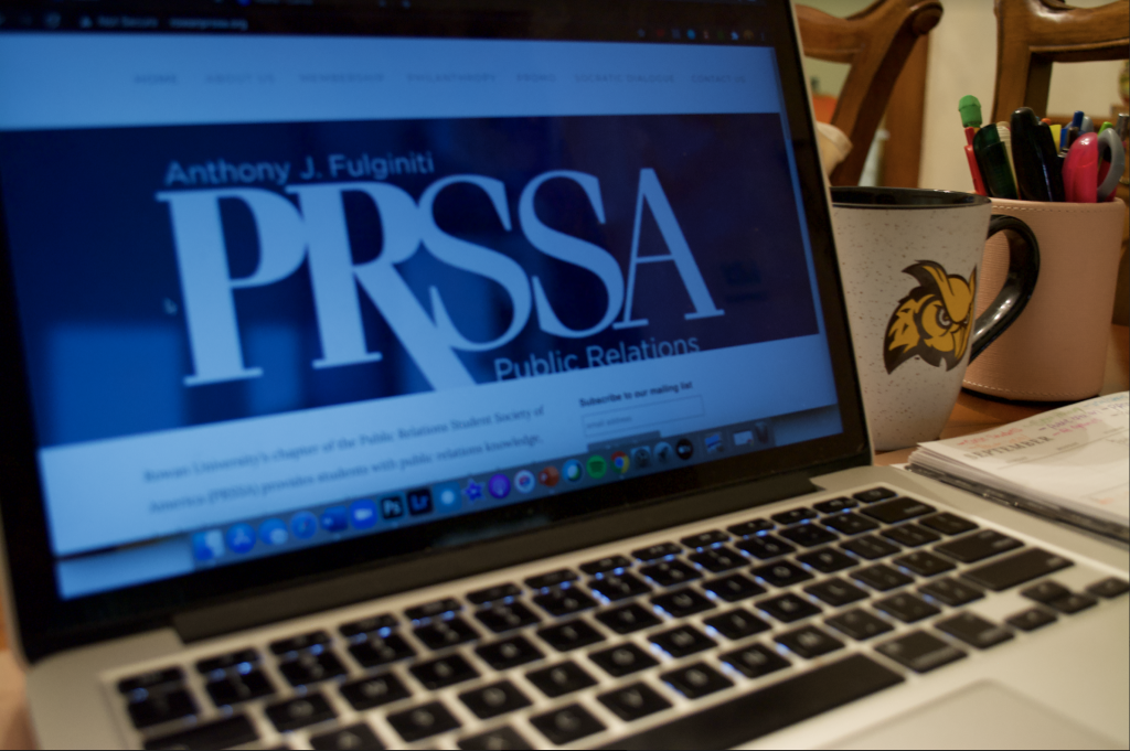 Jenna's computer screen displays the PRSSA website.