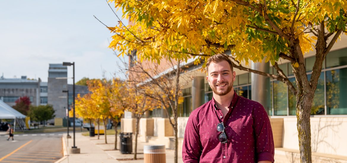 Elementary education student poses outside on campus.