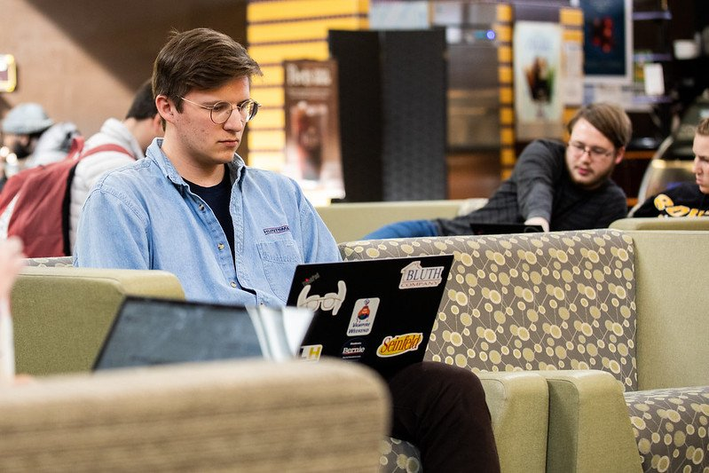 A student works on his laptop in the Student Center.