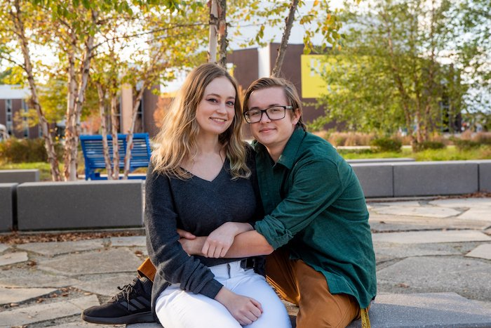 Alex sitting and hugging with her boyfriend.