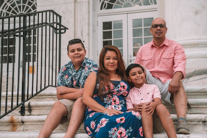 Sarah Giron with her family on the Bunce Hall steps.