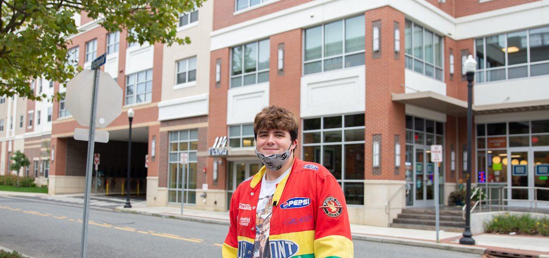 Nick stands on Rowan Boulevard