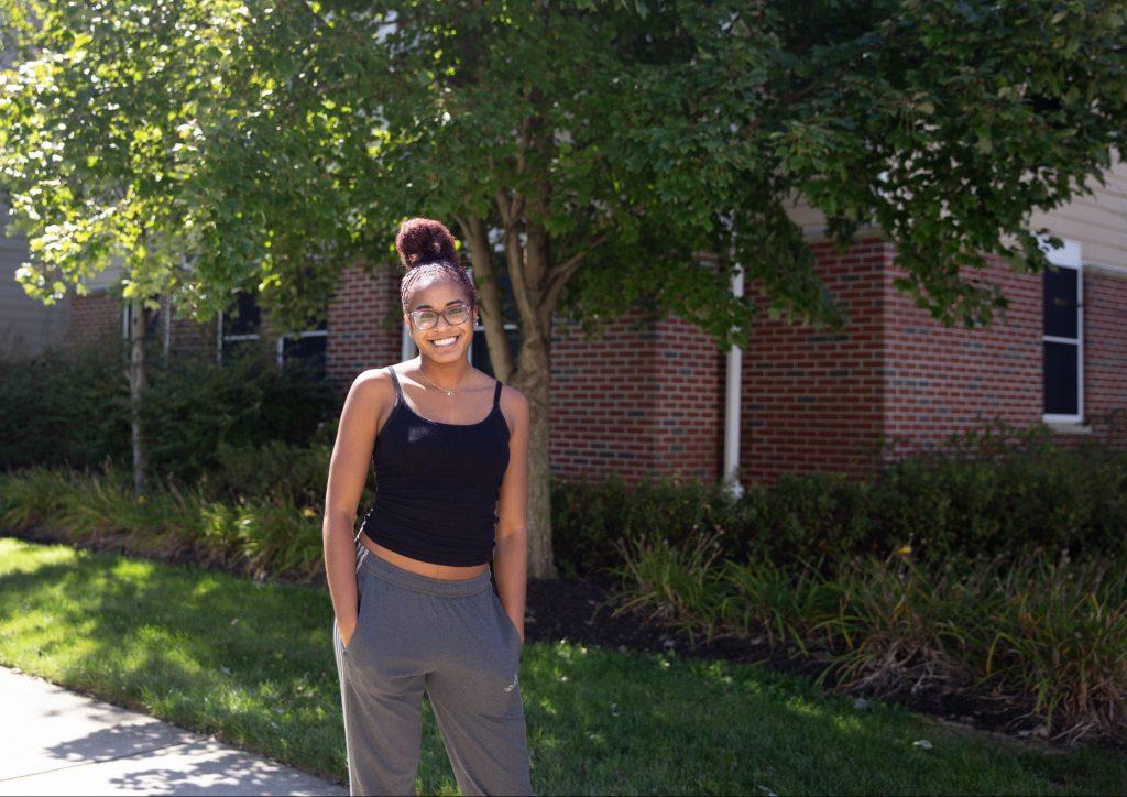 Jasmin poses outside of the Rowan Boulevard Apartments.