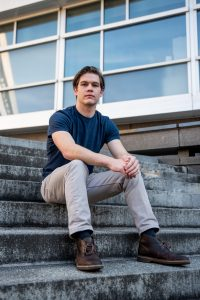 Liam sitting on the steps of Engineering Hall.