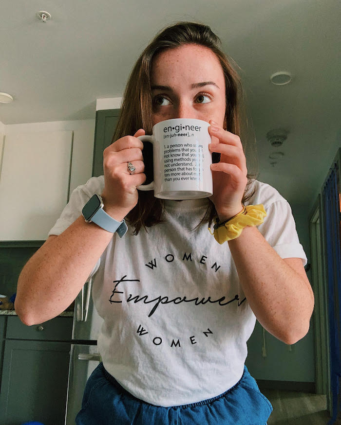 "Caroline drinking from a mug that says ""engineer"" and then provides the definition."