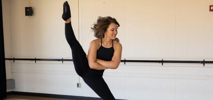 Photo of dancer Grace Koller in an upward split.