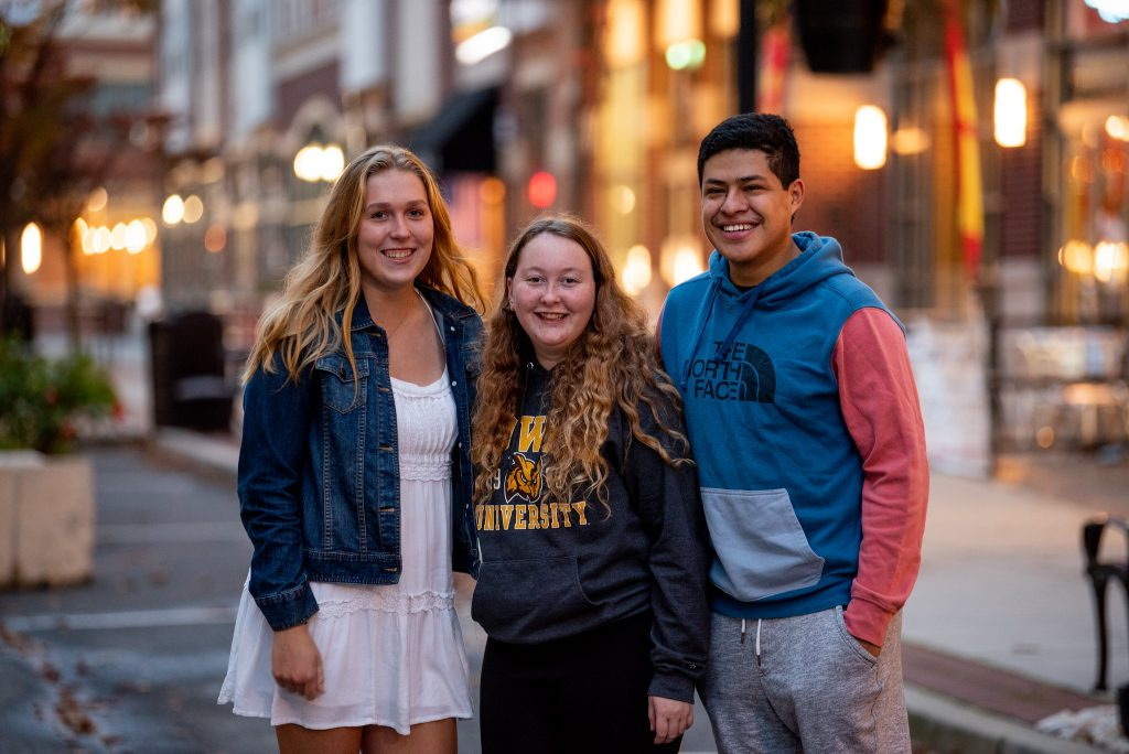 Taylor with her friends Rachel and Erwin from the Rowan Crew Club team.