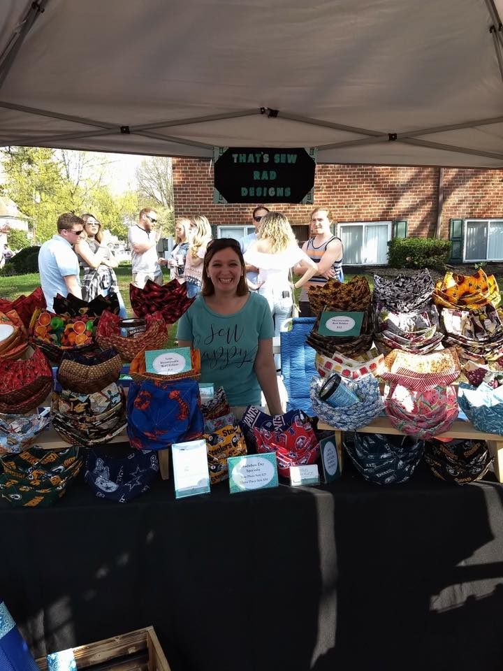 Jen at an outdoor event selling her items.